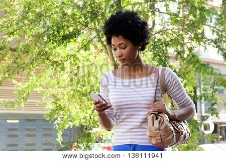 Beautiful African Woman Walking In The City With Cell Phone
