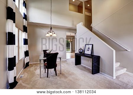 Open Floor Plan Dining Room With Carpet Floor