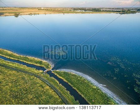 lake (Lonetree Reservoir)  and irrigation ditch in northern Colorado near Loveland - aerial view