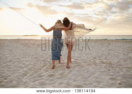 Woman Friends Enjoying A Day On The Beach