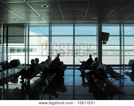 People silhouette in the waiting lounge in airport