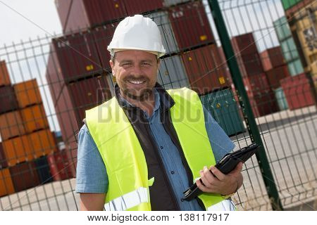 Handsome Logistics Manager At Container Transhipment Plant, With Electronic Tablet