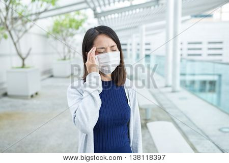 Woman suffer from sick and wearing face mask