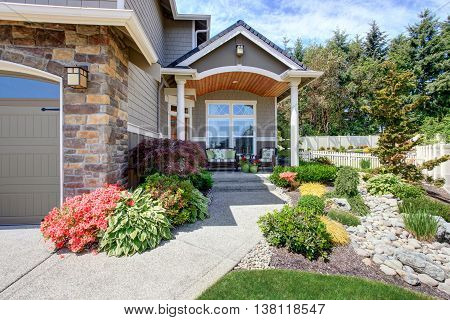 Home Exterior With Garage And Patio Area