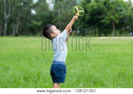 Little boy play his toy at outdoor