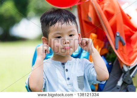 Little boy pinch on his ear