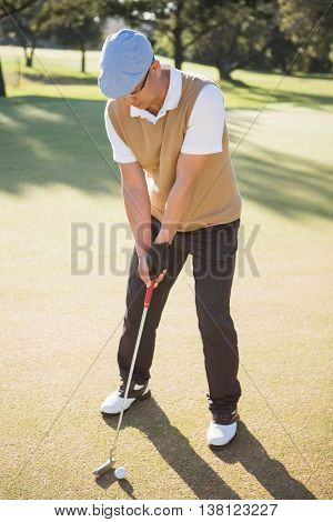 Portrait of sportsman playing golf on a field