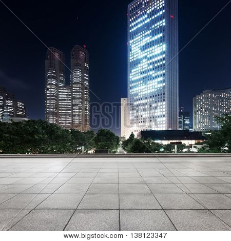 modern office buildings in downtown of tokyo at night on view from street