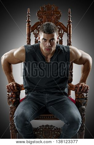 Terrible muscular man rises from his throne