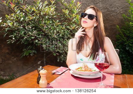 Lady Having Lunch And Thinking Outside On Terrace