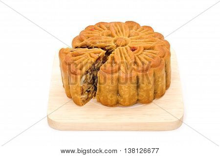 Mooncake on wooden plate for the chinese Mid Autumn festival, on white background