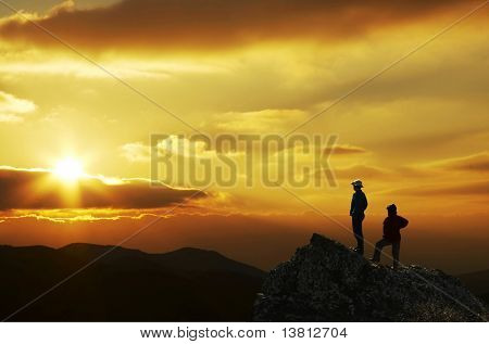 Man and women overview sunset landscape in Crimea mountain