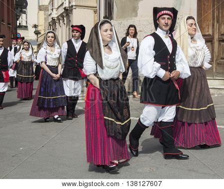 CAGLIARI, ITALY - May 1, 2013: 357 ^ Religious Procession of Sant'Efisio - Sardinia - group of people parade with the traditional Sardinian costumes