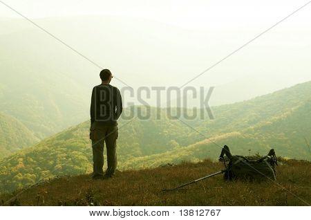 Alone man overview autumn landscape