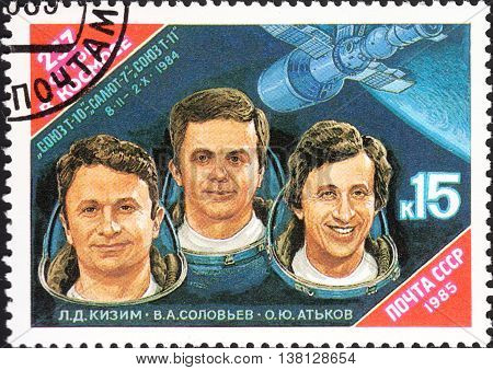 MOSCOW RUSSIA - DECEMBER 2015: a post stamp printed in the USSR shows portraits of L.D. Kizim V.A. Solov'ev O.Yu. Ot'kov devoted to Space Research circa 1985
