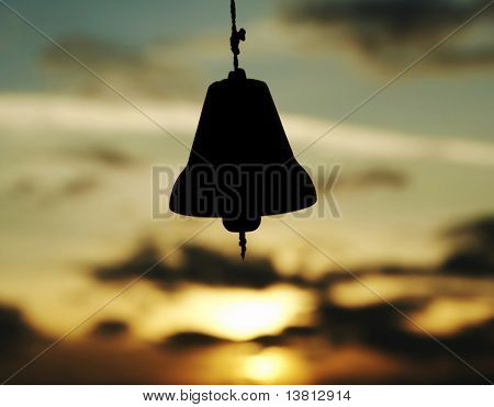 Ding silhouette on the sunset background