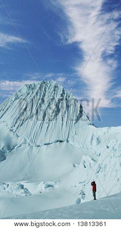 Climber looking on Alpamayo peak in Cordilleras mountain