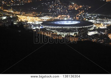 View of the Maracana stadium at night and the city around all lit
