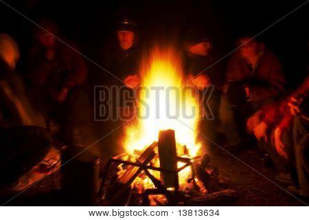 People around campfire
