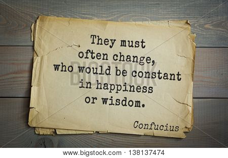 Ancient chinese philosopher Confucius quote on old paper background. They must often change, who would be constant in happiness or wisdom.
