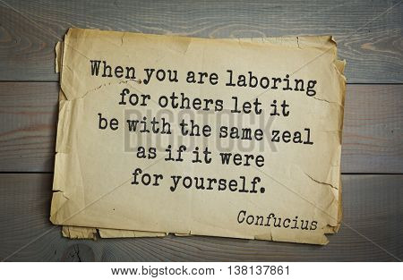 Ancient chinese philosopher Confucius quote on old paper background. When you are laboring for others let it be with the same zeal as if it were for yourself.