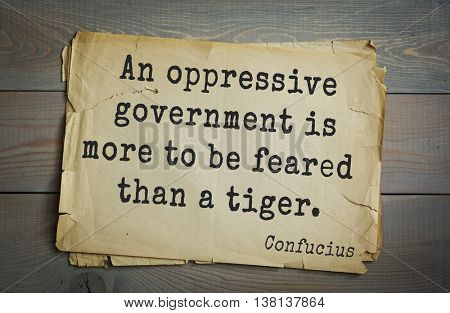 Ancient chinese philosopher Confucius quote on old paper background. An oppressive government is more to be feared than a tiger.