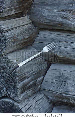 silver fork in blockhouse corner close up