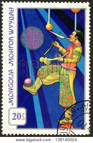 MOSCOW RUSSIA - DECEMBER 2015: a post stamp printed in MONGOLIA shows a juggler the series