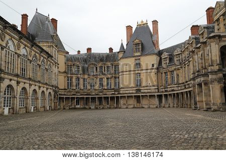 FONTAINEBLEAU, FRANCE - MAY 16, 2015: This part of the Palace of Fontainebleau forms a courtyard called the Oval courtyard.