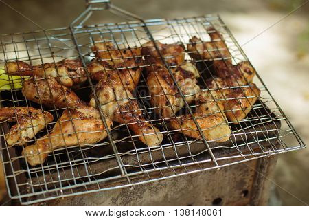 Barbecue. B-B-Q. Grille chicken meat on the grill. Summer rest.
