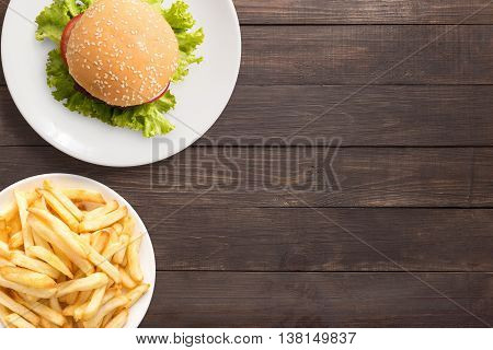 Top View Bbq Hamburger And French Fries On The Wooden Background