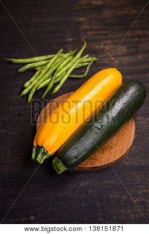two fresh ripe raw wet vegetables zuccini in studio