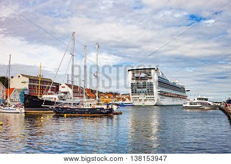 STAVANGER, NORWAY - JULY 13, 2015: Beautiful view on port with many boats, yachts and passanger ship on the background in Stavanger.