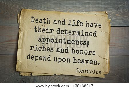 Ancient chinese philosopher Confucius quote on old paper background. Death and life have their determined appointments; riches and honors depend upon heaven.