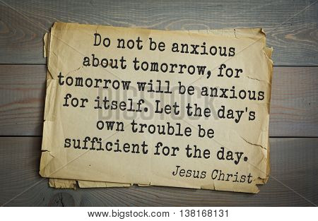 Jesus quote on old paper background. Do not be anxious about tomorrow, for tomorrow will be anxious for itself. Let the day's own trouble be sufficient for the day