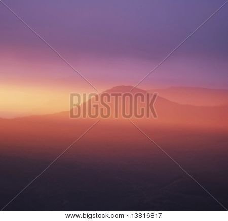 Peaceful pappy sunset in mountain