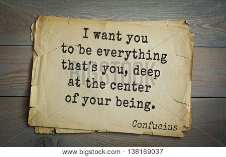 Ancient chinese philosopher Confucius quote on old paper background. I want you to be everything that's you, deep at the center of your being.