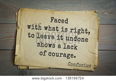 Ancient chinese philosopher Confucius quote on old paper background. Faced with what is right, to leave it undone shows a lack of courage.