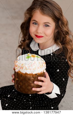 Young happy, funny, lovely, smiling, cheerful girl on her birthday, birthday party holding birthday cake, celebrate birthday. Happy birthday. Birthday portrait of cute attractive little girl with cake