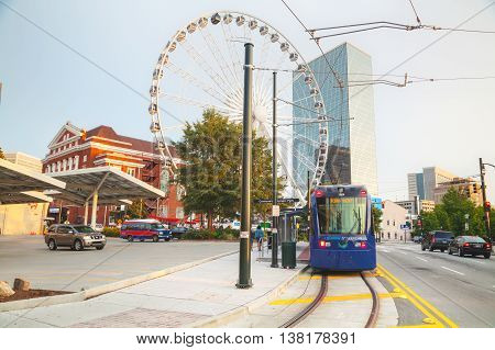 ATLANTA - AUGUST 29: Street car near the Centennial Olympic park with people on August 29 2015 in Atlanta GA.