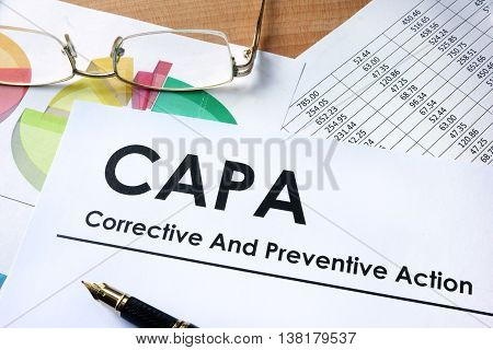 Paper with words CAPA Corrective and Preventive action plans