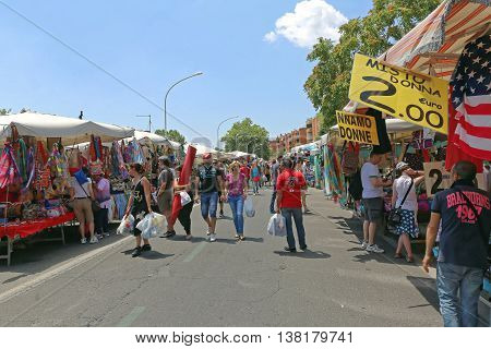 ROME ITALY - JUNE 29: Sunday Flea Market in Rome on JUNE 29 2014. People Browsing For Knick Knacks at Porta Portese Street Market in Rome Italy.