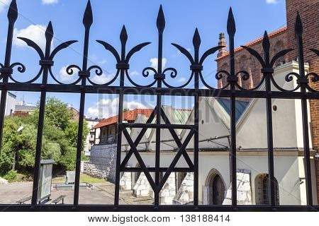 Star of David on metal fence of Old Synagogue in jewish district of Krakow - Kazimierz on Szeroka street in Poland