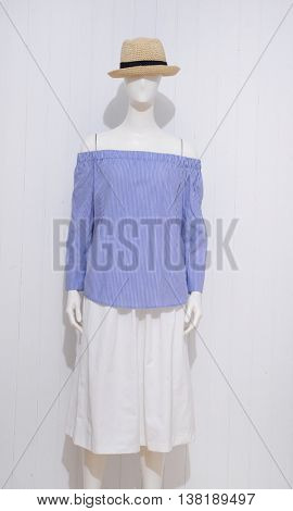 female blue clothing with hat on mannequin