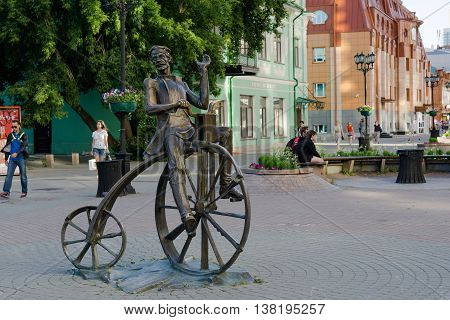 Yekaterinburg Russia - July 10 2016: The bronze sculpture of the inventor of the bike Artamonov set on the street Weiner in Yekaterinburg.