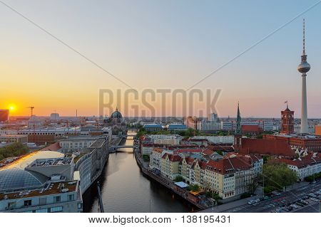 Sunset over the heart of Berlin with the river Spree and the Television Tower