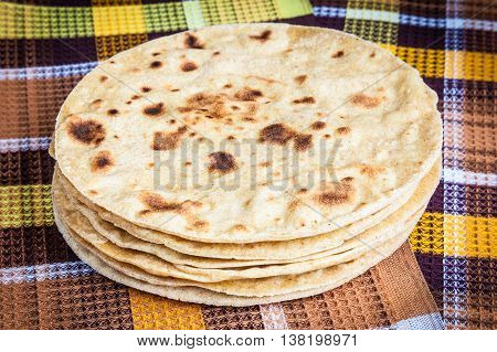 Freshly baked Mexican tortillas laid out on a towel