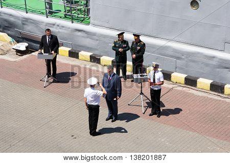 Odesa, Ukraine - July 03, 2016: President of Ukraine Petro Poroshenko awards sailors and soldiers on the pier of the Odessa port. Navy day celebration in Odesa