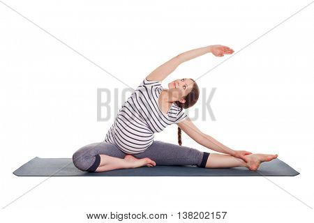 Pregnancy yoga exercise - pregnant woman doing asana Parivrtta janu sirsasana head to knee pose  isolated on white background