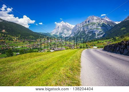 View To Famous Grindelwald Valley, Green Forest, Alps Chalets And Swiss Alps (schreckhorn, Berglisto